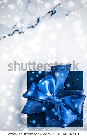 Blue silk ribbon and bow on luxury marble background, holiday fl Stock photo © Anneleven
