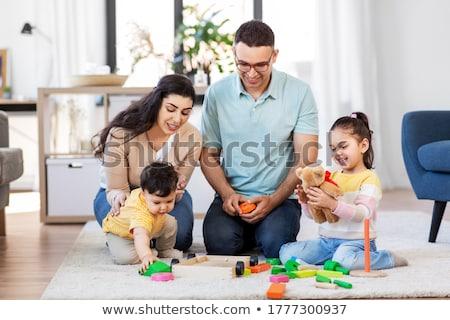 Baby chłopca ojciec piramidy zabawki domu Zdjęcia stock © dolgachov