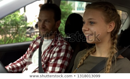 Driving instructor with student in car teaching how to drive Stock photo © Kzenon