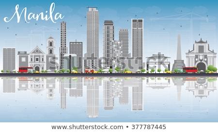 Manila Skyline with Gray Buildings and Blue Sky. stock photo © ShustrikS