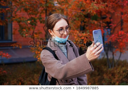 Woman talking with relatives during video call on smartphone Stock photo © dashapetrenko