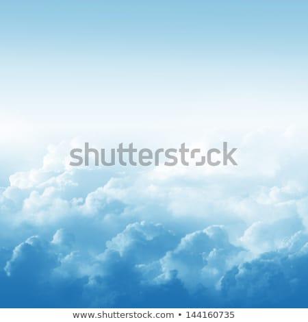 White clouds over blue sky stock photo © ribeiroantonio