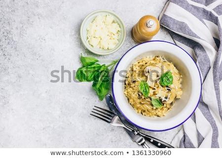 risotto of rice and mushroom stock photo © ziprashantzi