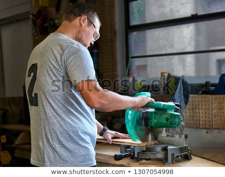 man using a mitre saw stock photo © photography33