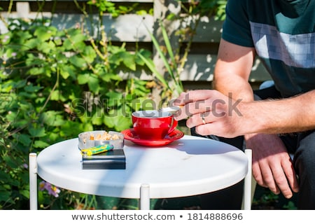 relaxing with cigarette stock photo © lisafx