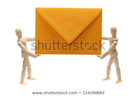 Two Wooden Dolls Holding Yellow Envelope Stock fotó © pterwort