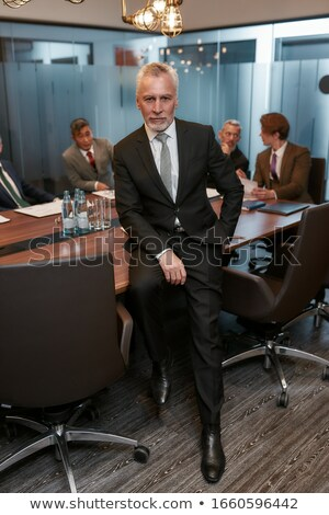 Confident businessman leaning on desk Stock photo © photography33