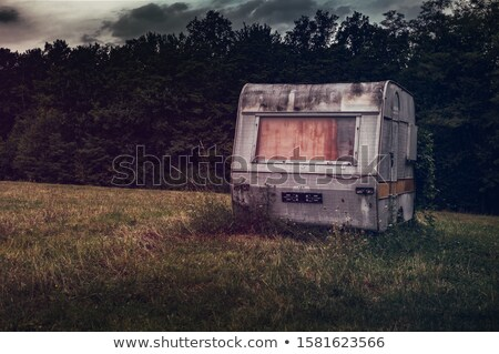 old trailer on meadow Stock photo © gewoldi