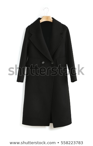 The young woman in a black coat. Isolated Stock photo © acidgrey