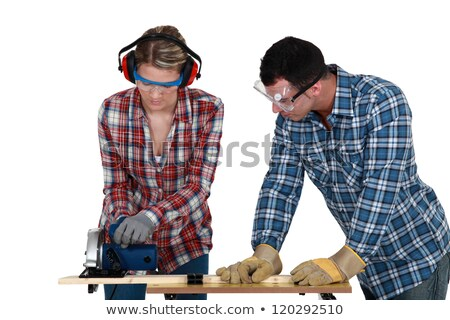 Tradespeople cutting a wooden plank with a circular saw Stock photo © photography33