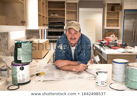 smiling tradesman looking at a blueprint stock photo © photography33