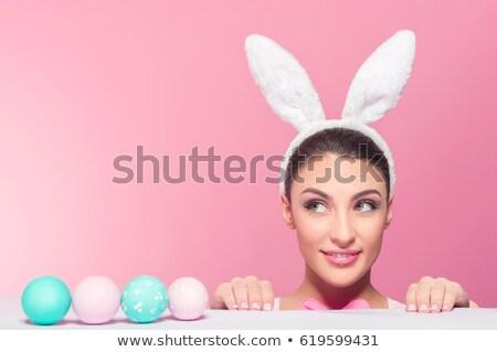 глядя красочный пасхальных яиц довольно женщину Сток-фото © Pasiphae