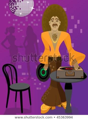 DJ playing vinyl LP records wearing Bell Botom Pants Stock photo © kittasgraphics