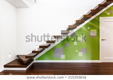 Interior of stylish modern house, Stairs with bright colored woo Stock photo © Bunwit