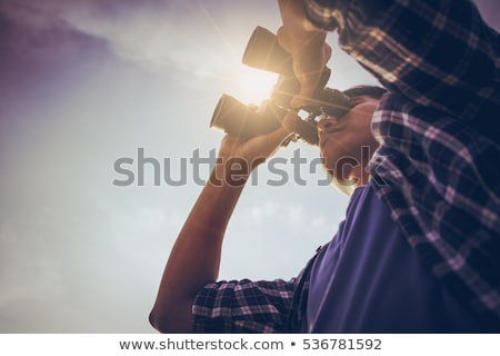 Close-up of man holding telescope Stock photo © zzve