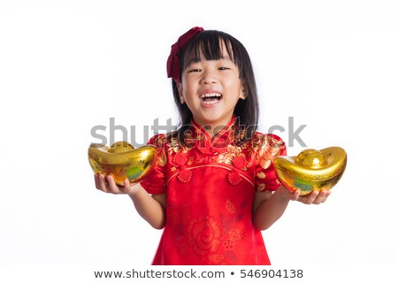Chinese girl holding a gold ingot Stock photo © szefei