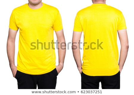 portrait of young beautiful man in yellow t-shirt Stock photo © stepstock