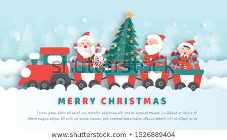 santa christmas train   baby gifts and penguins stock photo © jackybrown