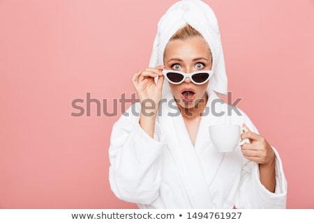 Fiatal nő áll fürdőköpeny néz megrémült fiatal felnőtt Stock fotó © bmonteny