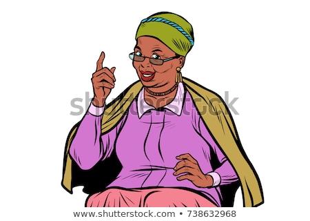 Senior vrouw wijzend omhoog communicatie witte Stockfoto © bmonteny