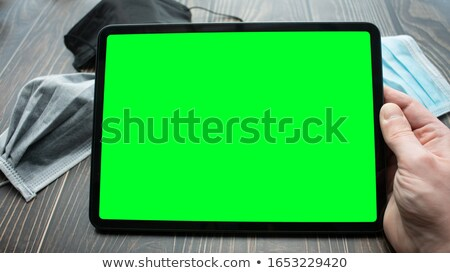 tablet in his hands stock photo © oleksandro