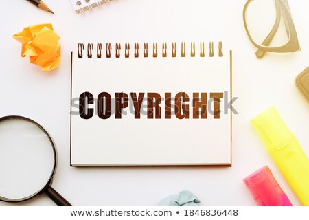 copyright   magnifying glass on old paper stock photo © tashatuvango
