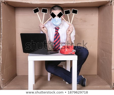 Businesswoman sitting on the office chair in front of broken wall Stock photo © cherezoff
