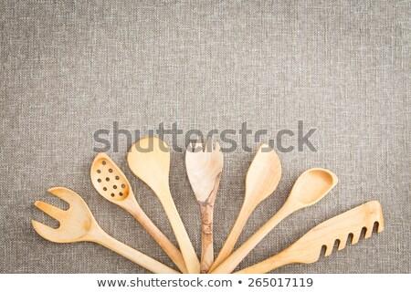 Fanned display of wooden kitchen utensils Stock photo © ozgur