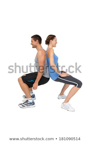 Side view of a fit young couple doing squats Stock photo © wavebreak_media