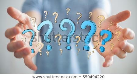 Man pushes a blue question mark Stock photo © boroda