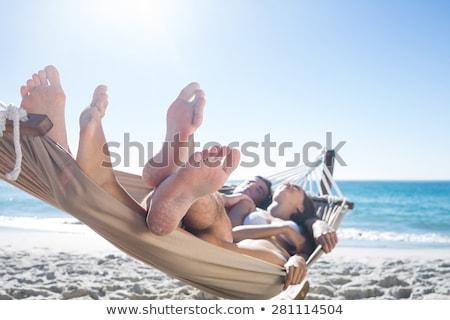 Boldog pár megnyugtató függőágy tengerpart nő Stock fotó © wavebreak_media