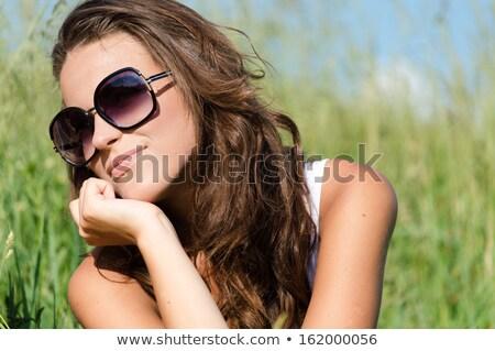 Smiling brunette wearing sun glasses Stock photo © wavebreak_media