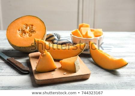 Melone fette coltello rustico tavolo in legno messa a fuoco selettiva Foto d'archivio © stevanovicigor