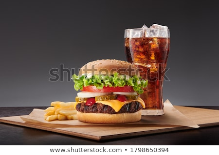 Burgers on grill and hamburger set with drink Stock photo © bluering