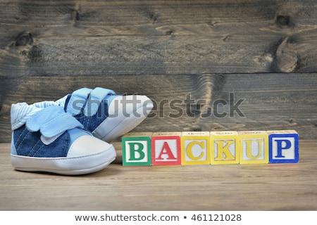 Gyerek cipők szó biztonsági mentés fa asztal számítógép Stock fotó © fuzzbones0