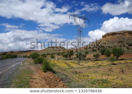High voltage transmission tower near rural road Stock photo © TasiPas