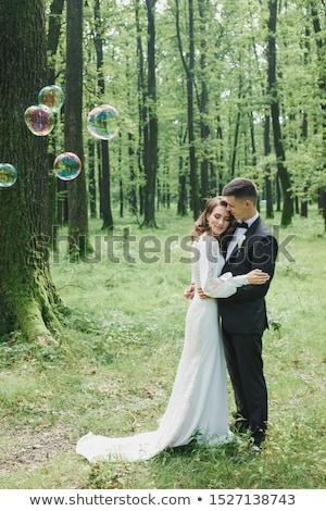 Menyasszony vőlegény erdő gyönyörű fut egyéb Stock fotó © tekso