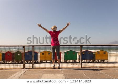 Kıdemli kadın silah ayakta telefon ev Stok fotoğraf © wavebreak_media