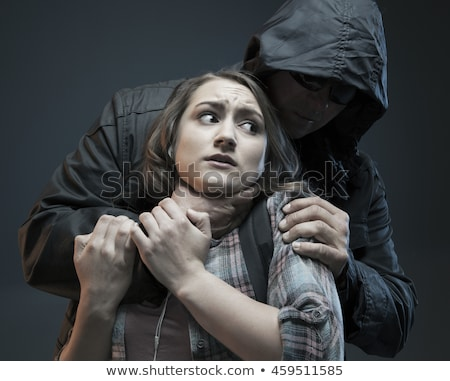 Woman choking her man Stock photo © deandrobot