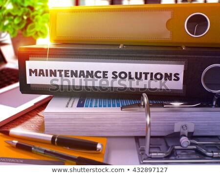 Maintenance Solutions on Office Folder. Toned Image. Stock photo © tashatuvango