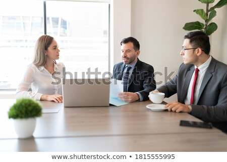three colleagues looking at some plans stock photo © is2