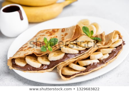 Cienki naleśniki bananów bita śmietana plastry czekolady Zdjęcia stock © Digifoodstock