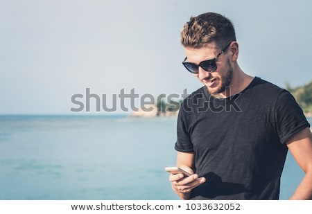 young man writing on the beach Stock photo © nito