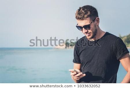 Junger Mann schriftlich Strand jungen Stock foto © nito