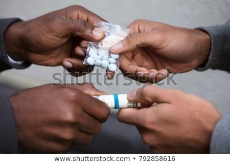 Személy vásárol drogok csere pénz közelkép Stock fotó © AndreyPopov