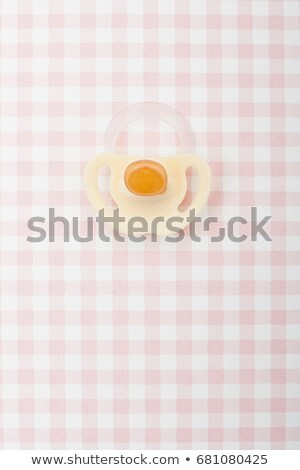 Pacifier on pink checker pattern Stock photo © IS2