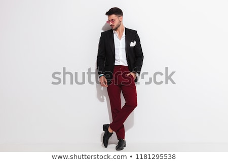elegant man posing while looking down to side Stock photo © feedough