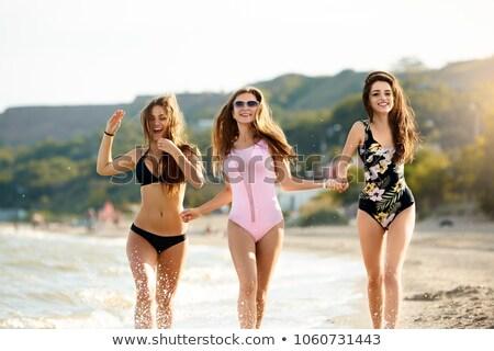 три счастливым прыжки бассейна , держась за руки Сток-фото © deandrobot