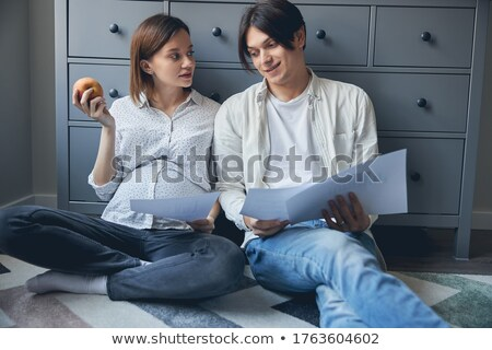 Man looking at his pregnant wife holding apple Stock photo © Kzenon