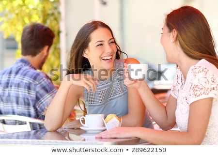 Young friends talking with each other drinking coffee outdoors winter concept holding bengal lights. Stock photo © deandrobot